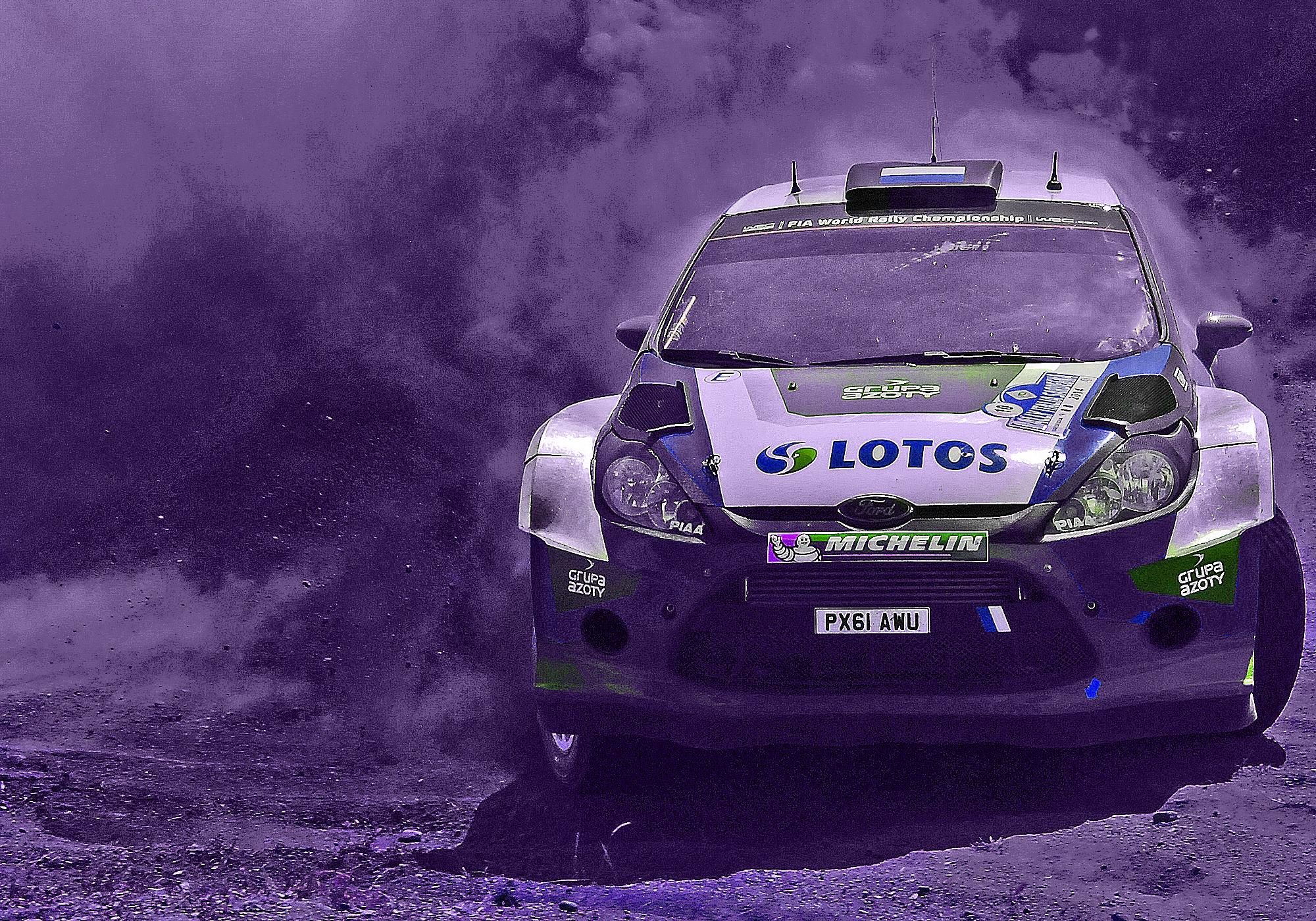 Rally car covered in sponsor logos
